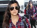 Kourtney Kardashian in plaid shirt at LAX