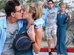 This is getting embarrassing! Charlie Sheen smothers porn star girlfriend Brett Rossi with hugs and kisses for third day in a row
