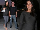 A little too in sync! Simon Cowell and pregnant girlfriend Lauren Silverman are matchy-matchy on art gallery date