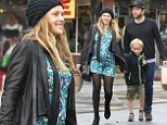 Three for the road! Pregnant Teresa Palmer wears retro floral frock as she takes her family on a rainy day shopping trip