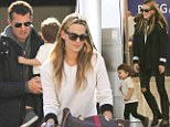 The turkey didn't weigh him down! Molly Sims' cute son is bursting with energy as the family flies into LAX