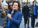 Daddy's little pirate! Orlando Bloom holds his toy-sword wielding son Flynn while on his way to Romeo and Juliet performance with Miranda Kerr