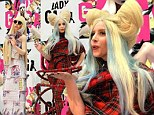 Tokyo City Roller! Lady Gaga steps out in red tartan jumpsuit as she comes face-to-face with life-size doll of herself