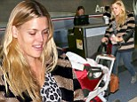 Working the holiday hustle! Busy Philipps balances a busy life with busy prints as she preps her newborn Cricket for a flight
