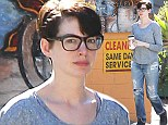 Anne Hathaway is geek chic as she steps out for coffee