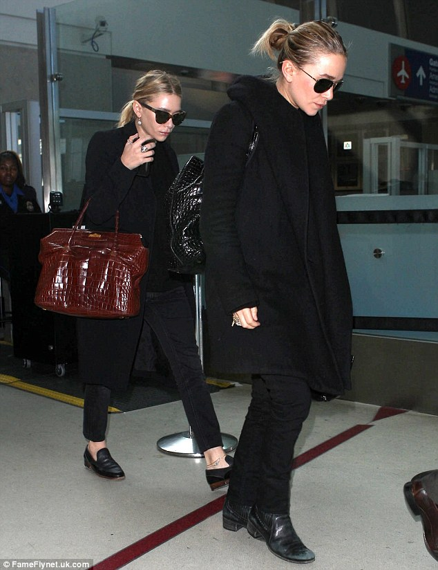 Twin-credible: Actresses Mary-Kate and Ashley Olsen arrived at LAX airport in Los Angeles on Thursday