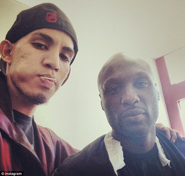Freshened up: On Monday Lamar Odom got his head shaved by his LA stylist Enzo just prior to a meeting with executives of the Lakers basketball team