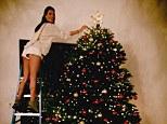Tree hugger: Model Allessandra Ambrosio wears short shorts while decorating her Christmas tree