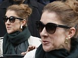 Sacre Bleu! Celine Dion pulls an unflattering facial expression as she steps out in Paris