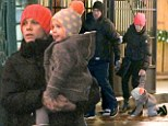 Keep calm and carry on! P!nk gives daughter Willow a lift after the two-year-old slips and slides on the icy streets of Toronto
