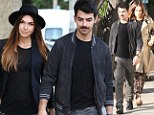 She can't make up her mind! Joe Jonas' high-maintenance girlfriend changes her outfit entirely during a date with the star