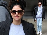 Wrapped up warm: Eliza Doolittle tones down her style just hours after she flashed her tummy in cut-out corset top