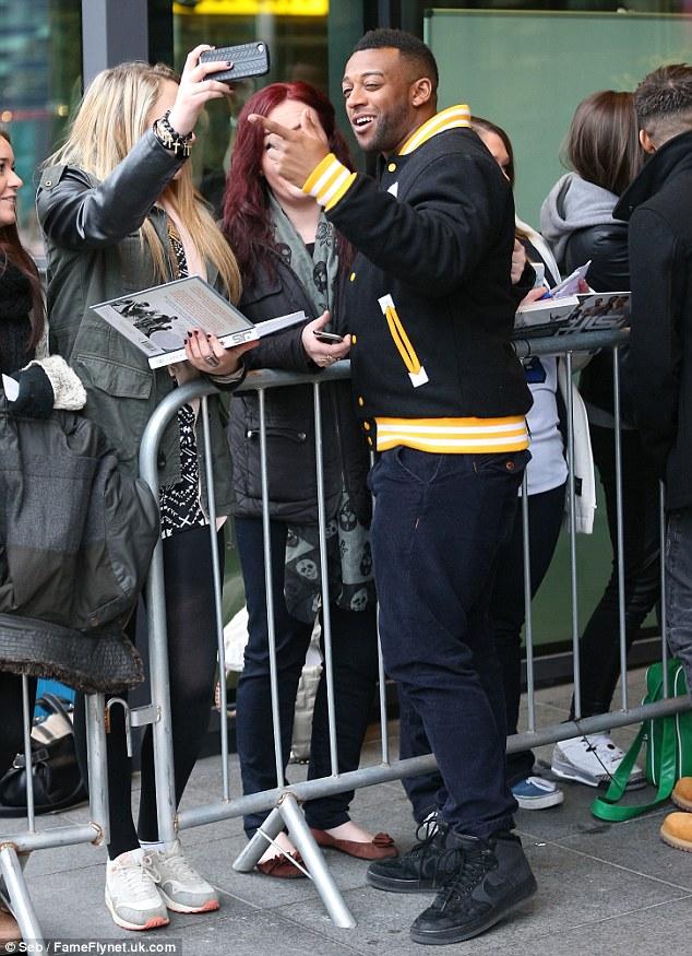 Pointing it out: The JLS star greets his fans on Thursday morning