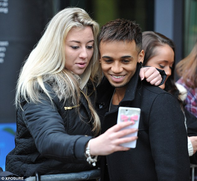 Popular: A blonde fan gets a photo with Aston