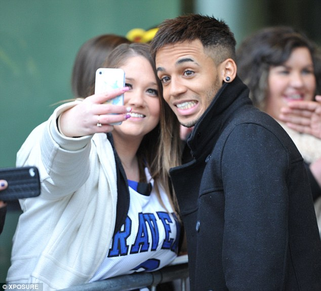 Say cheese: Aston poses for a shot with another young fan