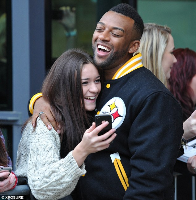 Making her day: JB gives the brunette a warm embrace
