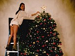 Tree hugger: Model Allessandra Ambrosio wears short shorts while decorating her Christmas tree