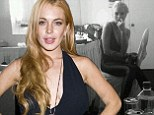 Lindsay Lohan poses for monochrome snap in untidy dressing room wearing figure-hugging leggings and plunging top