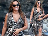 'I'm excited about being a mommy again': Basketball Wives star Evelyn Lozada debuts baby bump in Hawaii as she confirms she's six months pregnant
