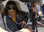 That's one way to keep warm! 'Engaged' Kelly Rowland hides her face in a scarf but still happily signs autographs for fans