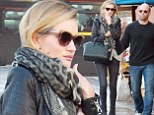 What's she hiding? Rosie Huntington-Whiteley covers up her left hand as she goes for a stroll with beau Jason Statham