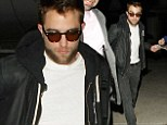 Headed home for Christmas? Robert Pattinson spotted at LAX looking glum in all-black outfit