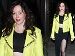 She's definitely not shy! Rose McGowan shows off her fantastic form in crop top and sexy split skirt for a shopping trip