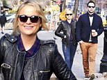 Happy couple: Amy Poehler and boyfriend Nick Kroll go for a stroll on Monday in New York City