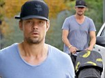 Going bananas! Josh Duhamel takes his boy Axl for a walk in fruity stroller... then heads for another workout at the gym