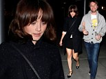 Mad about a boy! Alexis Bledel holds on tight to her fiance Vincent Kartheiser as they enjoy a rare date night together
