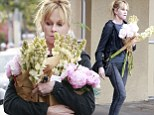 Blooming lovely! A makeup-free Melanie Griffith uses copious amounts of flowers to add colour to a grey old day