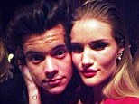 Harry Styles and Rosie Huntington-Whiteley pose cheek to cheek at 2013 British Fashion Awards