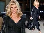Take that, scales! Kirstie Alley once again shows off her sexy new svelte figure in slimming black dress