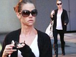 Showing the strain: A gaunt-looking Denise Richards steps out in LA as it's revealed social workers will investigate child abuse allegations this week
