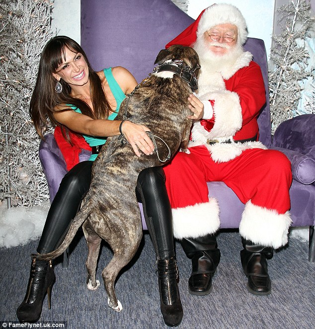 Sleigh alarm bells ringing: Santa looked a little disturbed when Karina Smirnoff's pitbull lunged at him