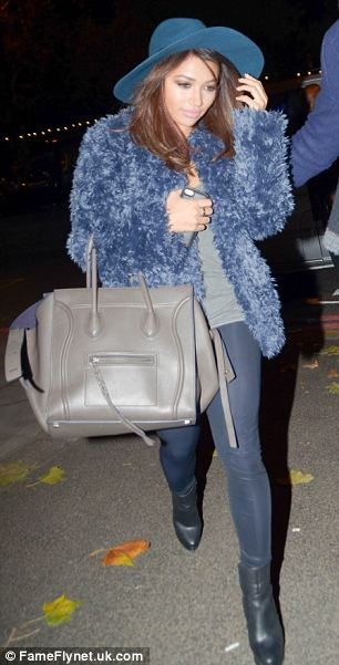 Bright: Vanessa Whire wore a colourful blue fluffy coat