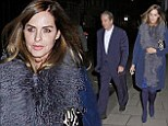 Looking blue: New couple Trinny Woodall and Charles Saatchi step out for dinner wearing the same shade of navy in London on Monday