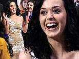 Helping them to roar! Katy Perry cannot stop smiling as she is announced as UNICEF's Goodwill Ambassador to help children find their voice
