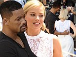 Arm in arm! Will Smith once again gets close to beauty Margot Robbie while on the Argentina set of new film as romance rumors continue to swirl