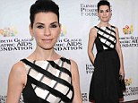 Seriously stunning! Julianna Margulies stands out in black and white crisscross dress to attend event for children's charity