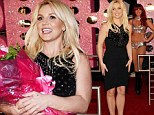 Doesn't she scrub up well? Britney shows off glossy blonde mane and stunning figure as she's received at Vegas welcoming party
