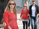 Pregnant Emily Blunt shows her growing bump in ruffled red sweater while shopping hand-in-hand with John Krasinski