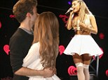 Close up and personal: The Wanted's Nathan Sykes hugs girlfriend Ariana Grande after her performance at 106.1 KISS FM Jingle Ball in Dallas on Monday