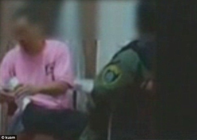 A maximum security inmate is secretly filmed giving a Corrections officer a foot massage in the U.S. Pacific territory of Guam