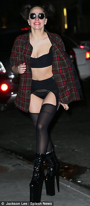How can you walk in those? Gaga wore a pair of her trademark huge platforms and was lucky she didn't trip while wearing sunglasses at night