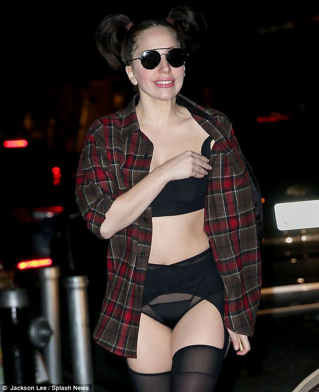 Outrageous: Gaga looked delighted with eye catching outfit in New York on Thursday night