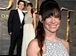 Gilded Lilly! Evangeline weaves her magic spell at The Hobbit: The Desolation Of Smaug premiere as she cuddles up to Orlando Bloom