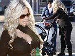 'They are doing awesome': New mom Kim Zolciak is well on her way to regaining her figure as she steps out four days after giving birth to twins