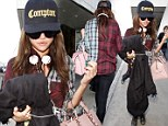 Selena Gomez keeps it casual in leggings and flannel shirt as she jets into LAX after showstopping appearance in Texas