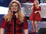 Full of Christmas spirit! Pregnant Kelly Clarkson glitters in red party dress to perform her new festive song on The Voice